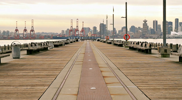 A view from a North Vancouver pier overlooking the Port of Vancouver cranes